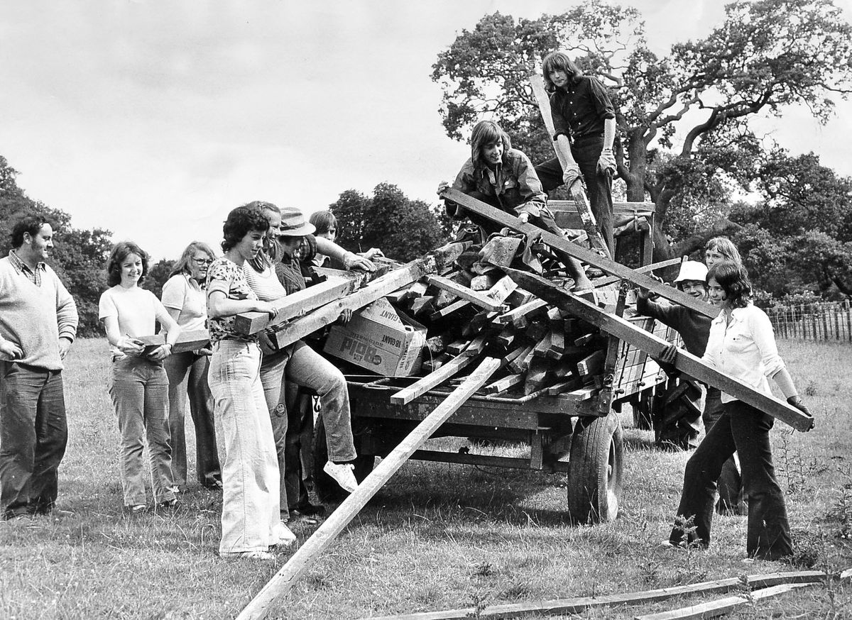 A study in 1970s fashions – just look at those flared trousers. It's July 12, 1974, and another day starts for a group of volunteers from all over the country who had been spending a week at Attingham Park, near Shrewsbury, working on the 1,000 acre National Trust estate. Left is estate foreman David Hilditch.