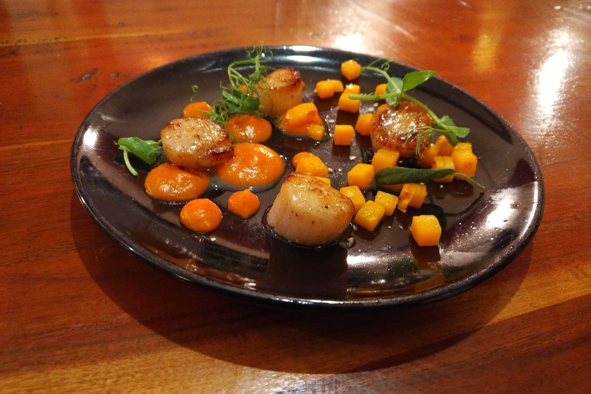 The pan-seared scallops served with butternut squash