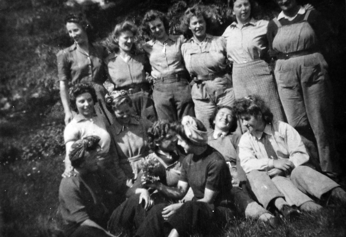 Land Army girls from Llanforda Hall, near Oswestry, during the war. Barbara is bottom right. Next to her with her head thrown back is her best friend, Mabel Jones, from the Newtown area.