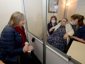Fundraising lead Gill Kelly chats to her mum Eleanor in the visiting pod