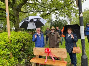Councillor Brian Colley, left, with wood carver and artist Jim Heath and Councillor Dot Griffiths