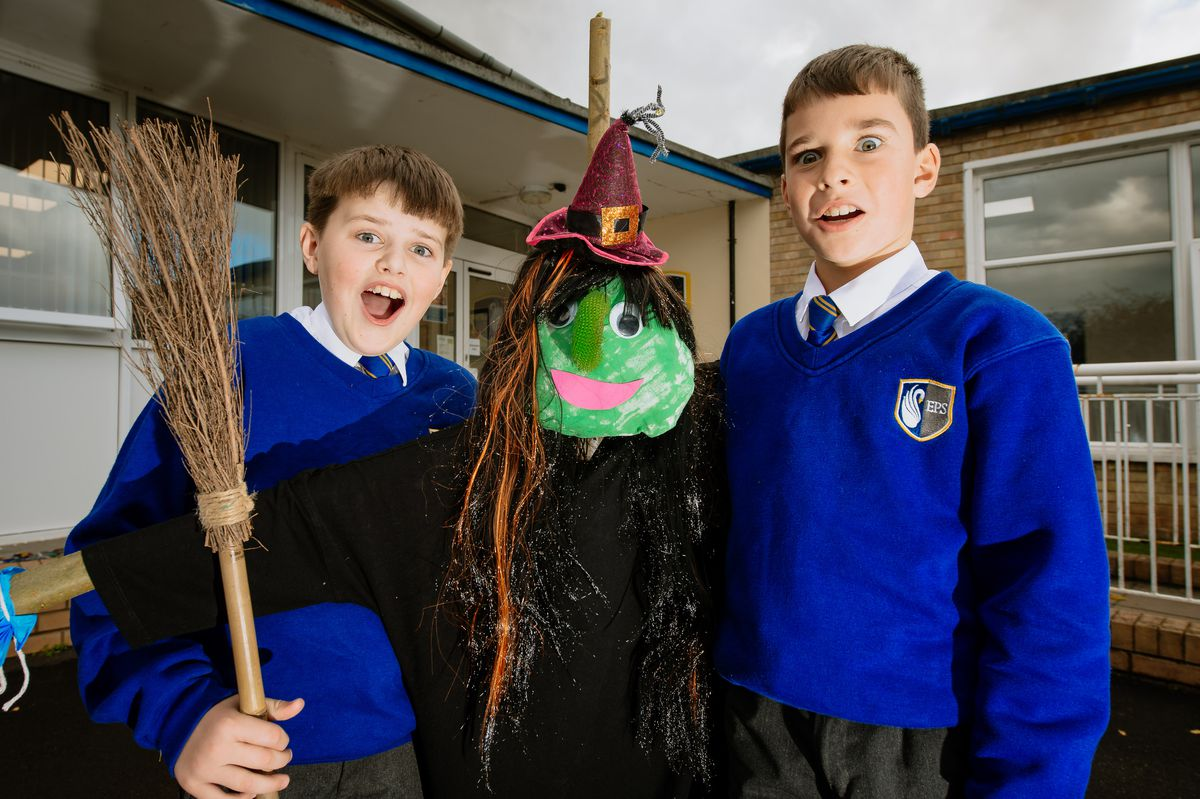 Charlie Griffiths 9 and Lennon Debicki 9 of Ellesmere Primary School with one of the scarecrows