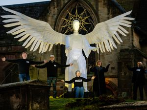 A huge Angel sculpture has been put on display out of St Mary's Church in Ellesmere created by Fizzgigs the Ellesmere Community Arts Group Pictured are: Ian Andrew, Peter Cartledge, Claire Cartledge, Rev Pat Hawkins and Tony Lewery..