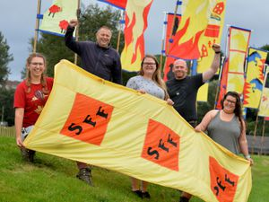 From left are Melissa Roberts, Richard Veal, Alison Jackson, Dan Sheffield, and Helen Beck, preparing for the festival