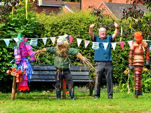 Looking at pots in the theme of Wizard of Oz, at Boughey Road, Newport, borough council ward member Peter Scott