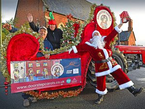 Nick and Mary Lewis seen preparing the sleigh which will be doing the rounds, with Santa Caroline Cartner
