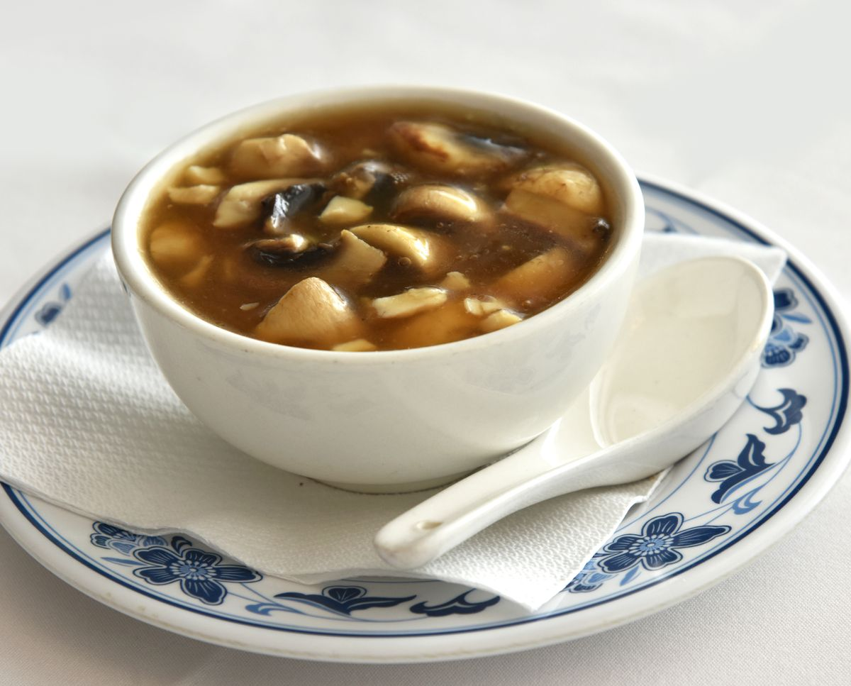 A bowl of chicken and mushroom soup