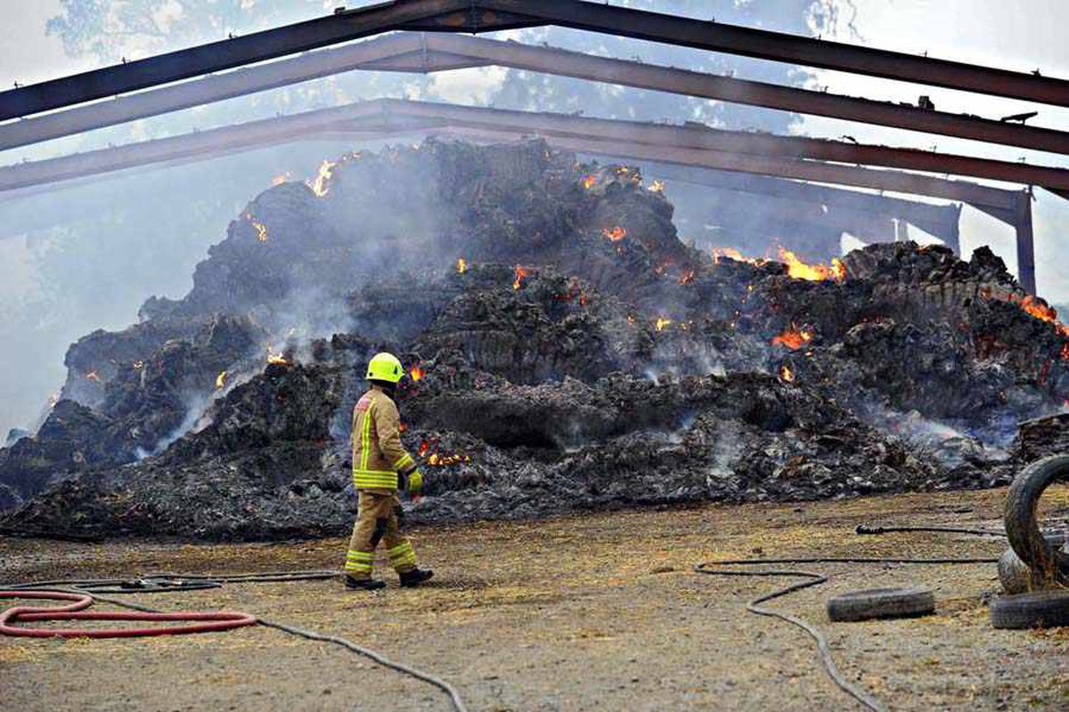 About 30 firefighters from the Mid Wales area were called to the scene in order to tackle the blaze which hit farm buildings near Arddleen