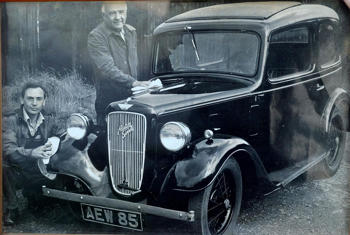 Reg working with his father, also called Reg, on an old Austin 7 in the 1970s