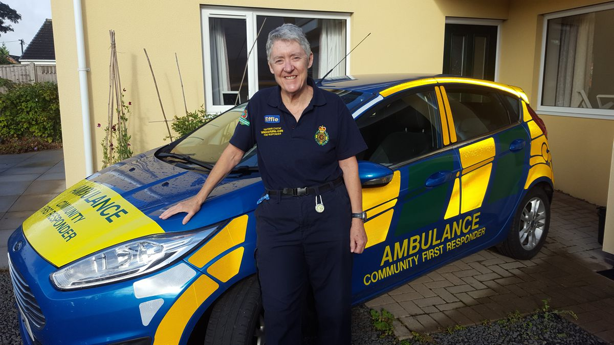 Effie Cadwallader with the car from her days volunteering with the West Midlands Ambulance Service