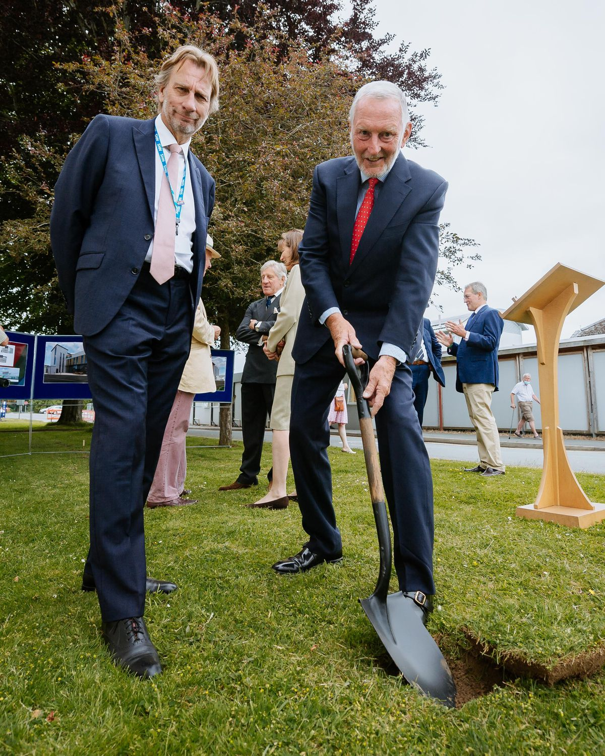 Air Vice Marshal Anthony J. Stables cuts the first turf with RJAH trust chairman Frank Collins