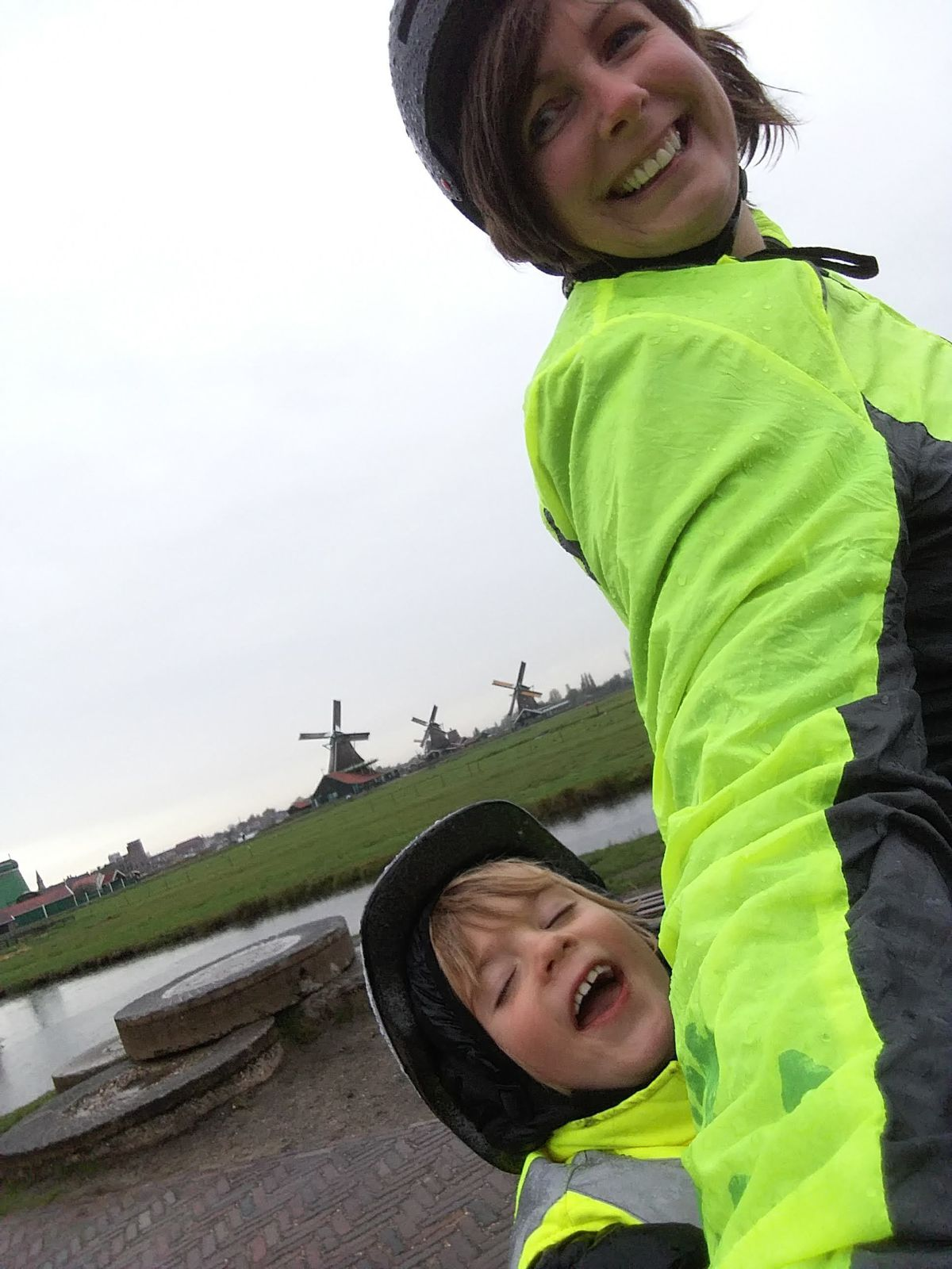Lea and Harrison taking a bike ride past the windmills in Amsterdam