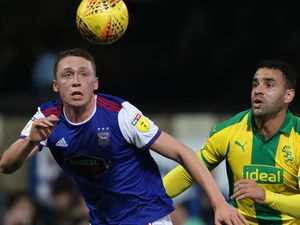 Matthew Pennington of Ipswich Town and Hal Robson-Kanu of West Bromwich Albion.