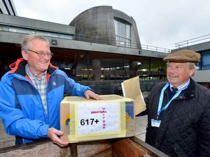 Shifnal Matter representative John Moore handing over consultation responses to Shropshire Council leader Peter Nutting