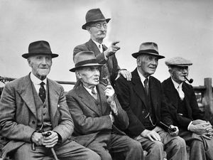 """nostalgia pic. Bridgnorth. Five old men, four of them smoking pipes. Significance of picture unknown, but it is an old Wellington Journal and Shrewsbury News print and will no doubt have been used with an explanatory story of some sort. Possibly they were all from Bridgnorth as seated second from left is Bridgnorth undertaker Jim Howard. This is a framed picture at the home of Frank Foxall, 9 Hopkins Heath, Shawbirch, born September 20, 1937. foxall2037@sky.com , 01952 256182. Frank thinks it shows a group of Bridgnorth octogenarians..""""I think it is a group of gentlemen who used to meet on the cricket ground. My wife's mother's father is on it, Jim Howard."""". Frank's wife Joyce, nee Truelove, said: """"He lived in St Mary's Street and was an undertaker. He made the coffins. He is second from the left in the picture..""""When I was a little girl I said 'Granddad, can you make one for me?' He said 'No, I won't.' I thought 'How mean.'.""""But he did make one for his wife, my nan, to use as an ironing board."""" The print has the Wellington Journal and Shrewsbury News copyright stamp, but no date. Pipe smokers. Pipe smoking. Library code: Bridgnorth nostalgia 2020.."""