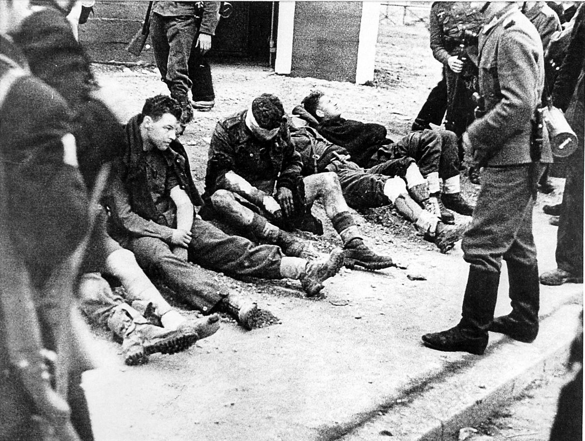 A rare German propaganda photograph showing Bill 'Tiger' Watson and his colleagues after they were captured