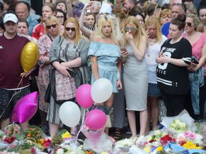 Floral tributes in St Ann's Square, Manchester, to remember the victims of the Manchester Arena attack