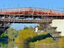 Iron Bridge covers red-y to come off