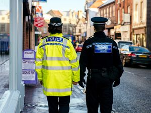 Police Officer and Police Community Support Officer walk the streets of Oswestry..
