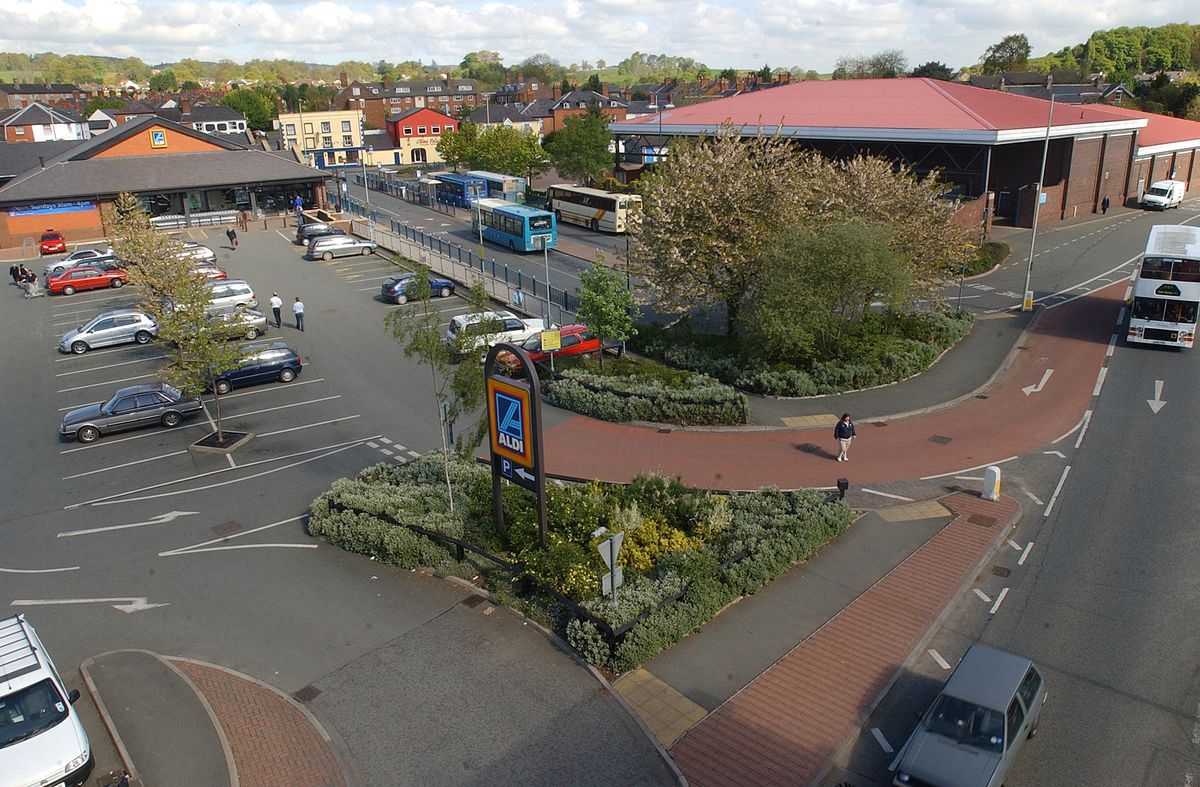 Oswestry Bus Station, off Oswald Road, sandwiched between Aldi and the former Morrisons store