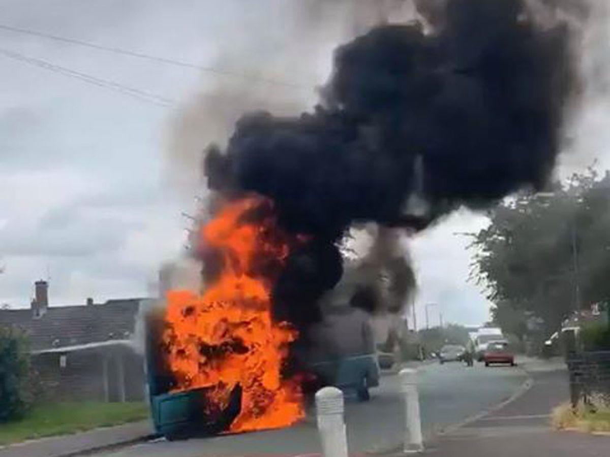 The blazing bus. Photo: Jonathan Barker