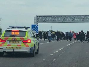The M6 was partially closed as more than 100 protestors walked between Junctions 2 and 3