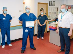 Barney Pitt, Anaesthetic Nurse, receiving the Health Hero Award from Mark Brandreth, Chief Executive, with David Blackwell, Anaesthetic Manger, and Claire Heathfield, Recovery Manager