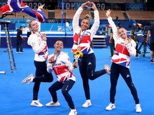 Alice Kinsella, Jennifer Gadirova, Jessica Gadirova and Amelie Morgan celebrate with their bronze medals