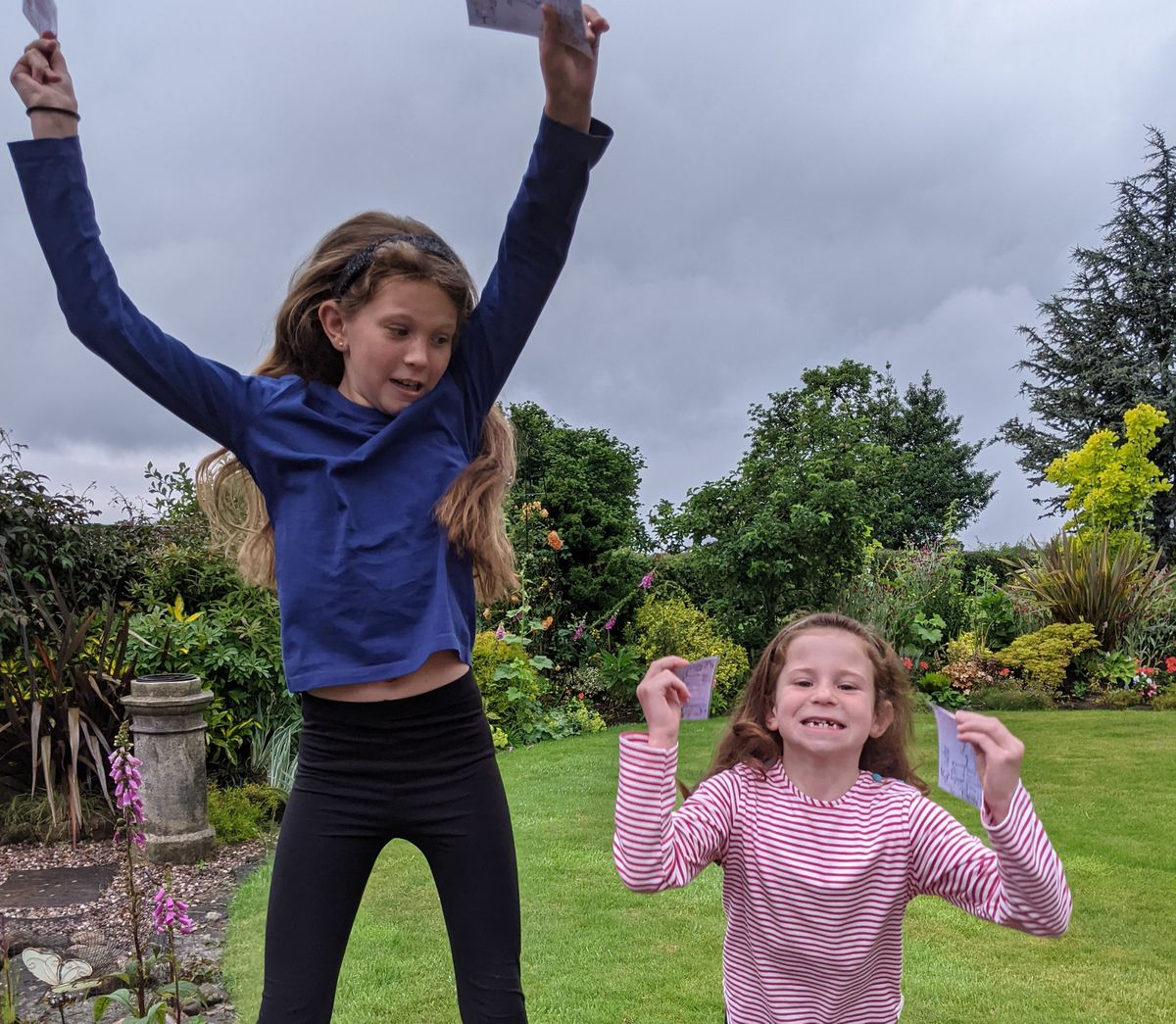 Ten-year-old Sophie Dahn and her six-year-old sister Lucy jumping for joy when they heard they were amongst the winners of Newport Rotary Lite's Spot the Oddity competition