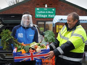 Scott Robson, of Wolverhampton, from Online Fruit and Veg, with (right) market manager Warren Prosser, during Lydham Friday Market