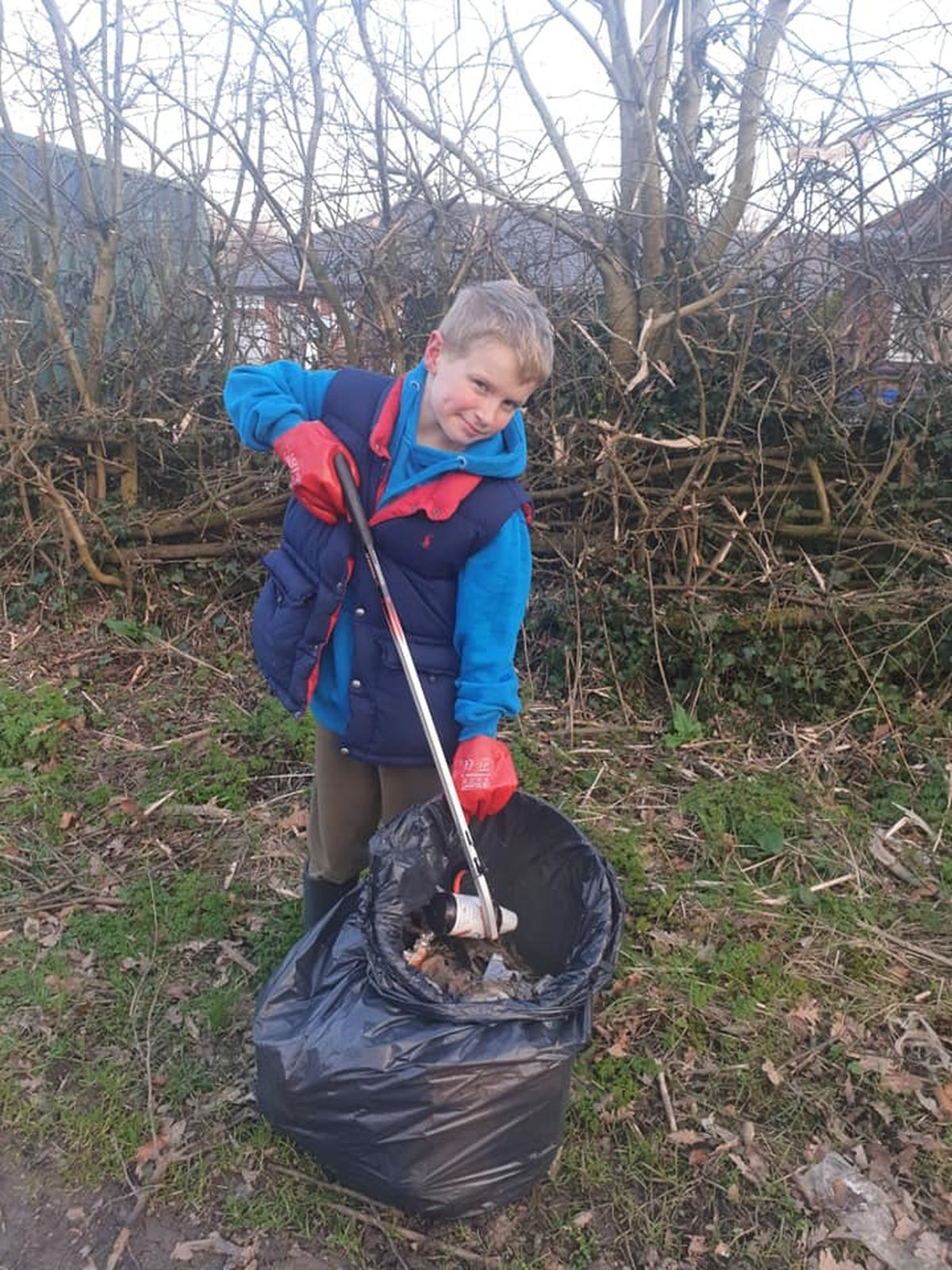 Edward filling another bag of litter