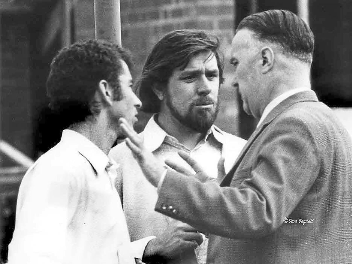A photograph by Dave Bagnall of the builders' strike as discussions take place, with Ricky Tomlinson, centre