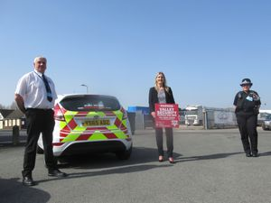 A member of Valley Security with Adele Nightingale from the Business Improvement District