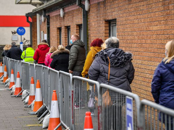 People queue for vaccines in Wales