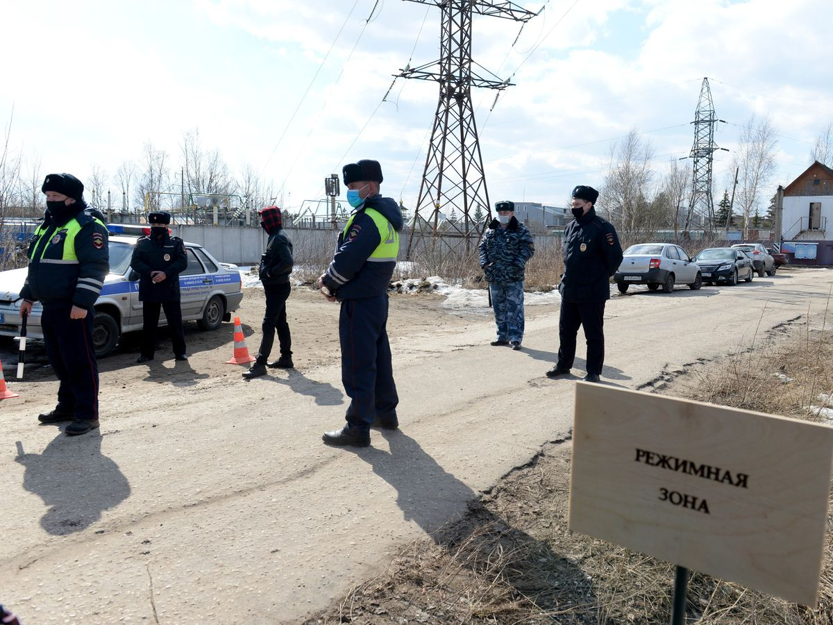 Police officers stand at the ntrance of the prison colony IK-2 (Denis Kaminev/AP)