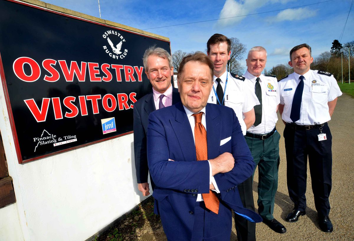 Rod Hammerton, chief officer of Shropshire Fire and Rescue Service, right, with Owen Paterson left, roads minister, John Hayes and other emergency service leaders.