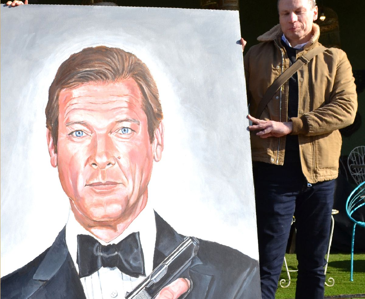 Gary Matthews with one of his large-scale portraits of Roger Moore as James Bond