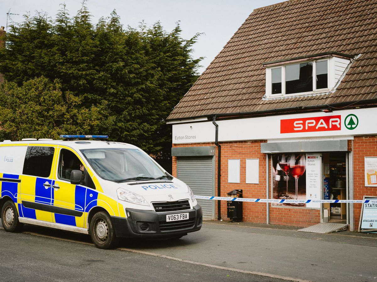 Police at the scene in Eyton Road, Dawley