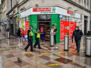 Police patrol the central shopping areas of Cardiff
