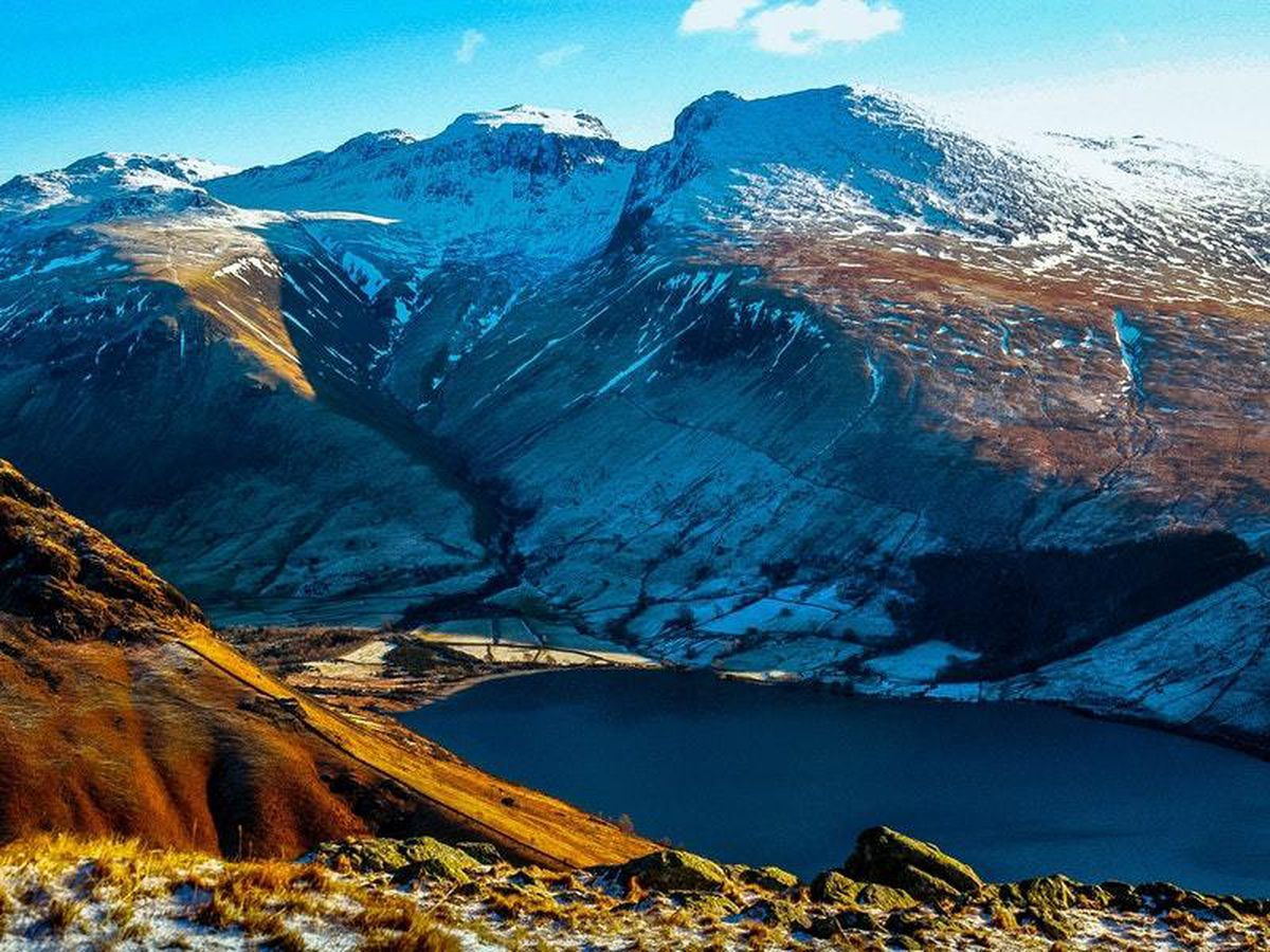 The National Trust is raising membership fees to fund its biggest ever programme of conservation, including work on Scafell Pike (John Malley/National Trust/PA)