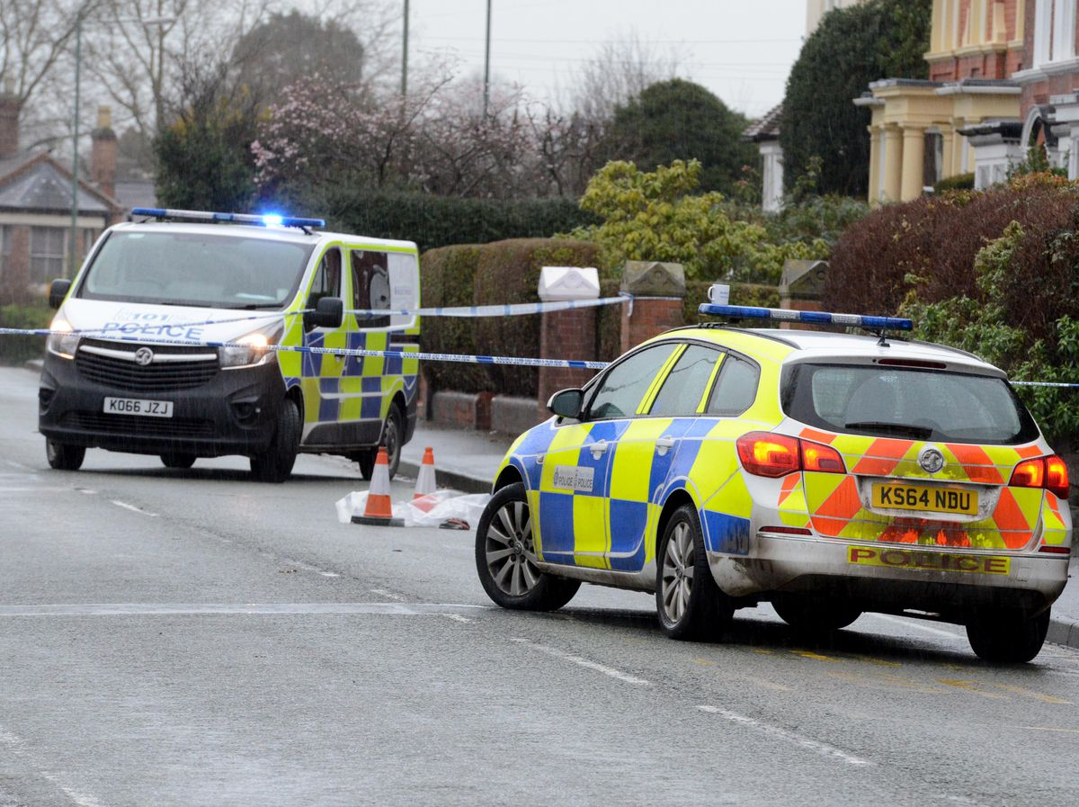 Police at the scene on Hereford Road, where two men were stabbed
