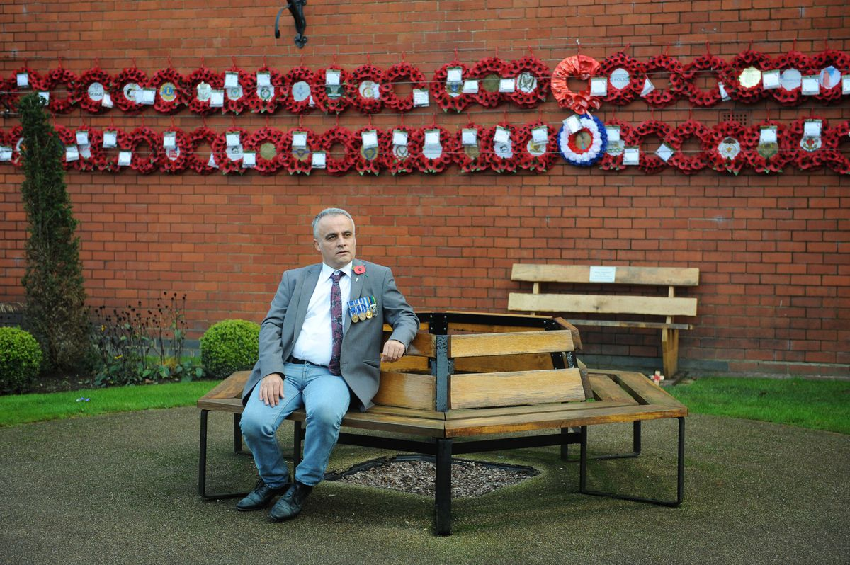 Councillor Mark Whittle with the wreaths