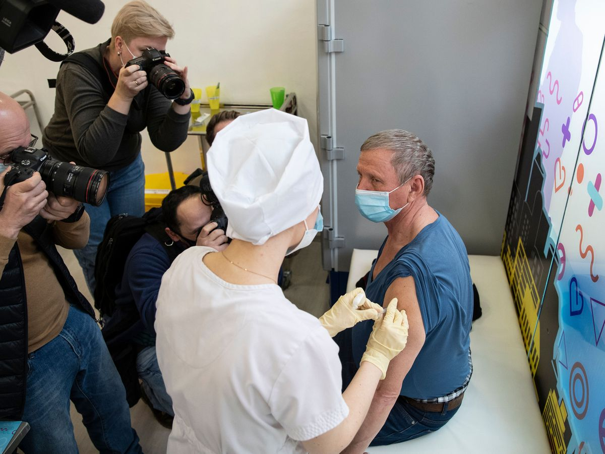 A medical worker administers a jab of Russia's Sputnik V coronavirus vaccine in Moscow, Russia (Pavel Golovkin/AP)