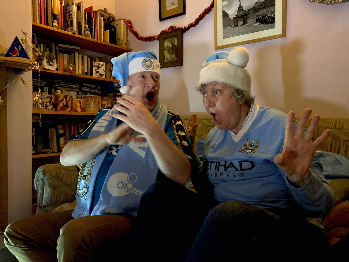 Lifelong Manchester City fans Cath and Dougal Brice react as Che Adams goes close for Southampton in a match shown live by Amazon on December 19, 2020. The picture is part of a new Homes Of Football exhibition at the National Football Museum in Manchester
