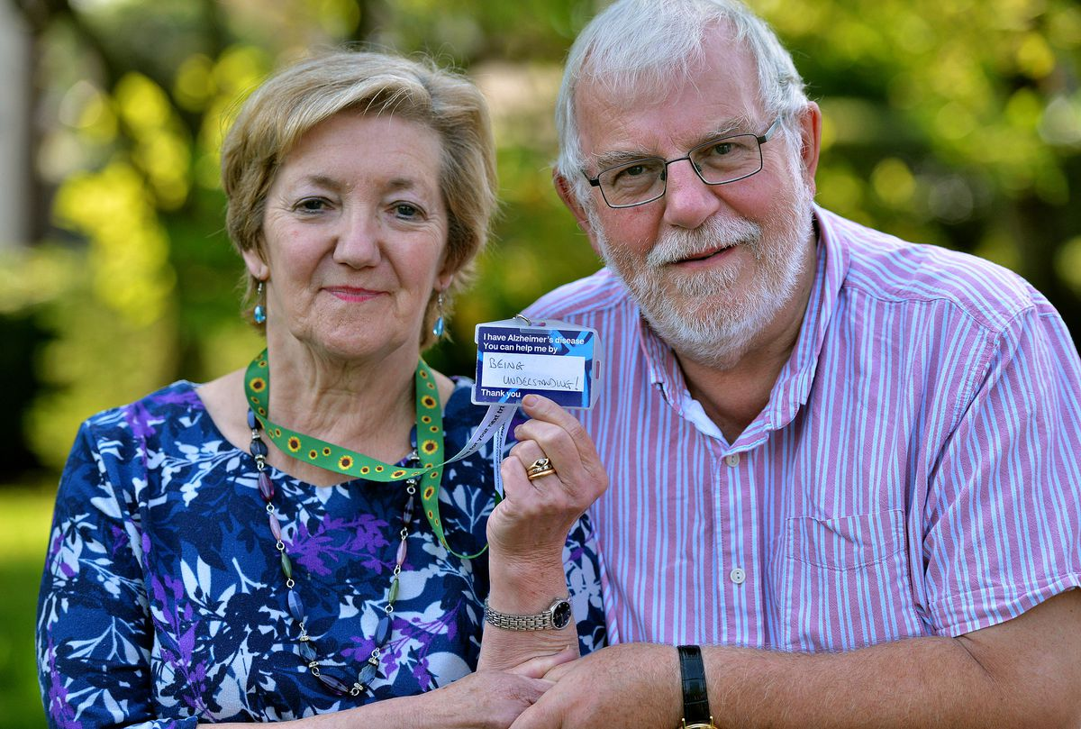 Alzheimer's sufferer Cheryl Hayes, 67, with husband David. She wears a lanyard to let other people know about her disability.
