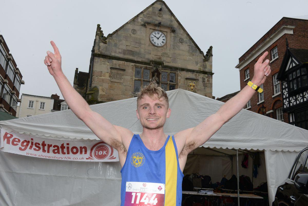 Jamie Lambie celebrates winning the Shrewsbury 10K
