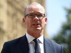 Irish government not portraying draft Brexit deal as victory – Coveney