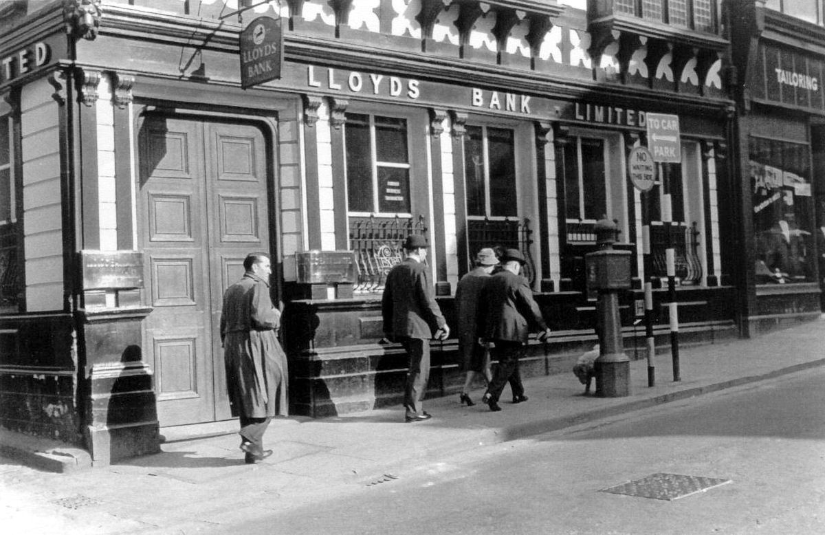 """The old Lloyds Bank in Pride Hill, Shrewsbury, as seen in a picture thought to have been taken in 1960. Despite its Tudor appearance, the frontage bore the date 1876. It was replaced with a modern bank building which won a Civic Trust design award in the late 1960s. The assessor said of the 1960s replacement: """"It makes a mockery of the pseudo-traditional and pseudo-modern buildings in Shrewsbury and points the correct way for those with eyes to see.""""Picture: Abbeycolor, Shrewsbury."""