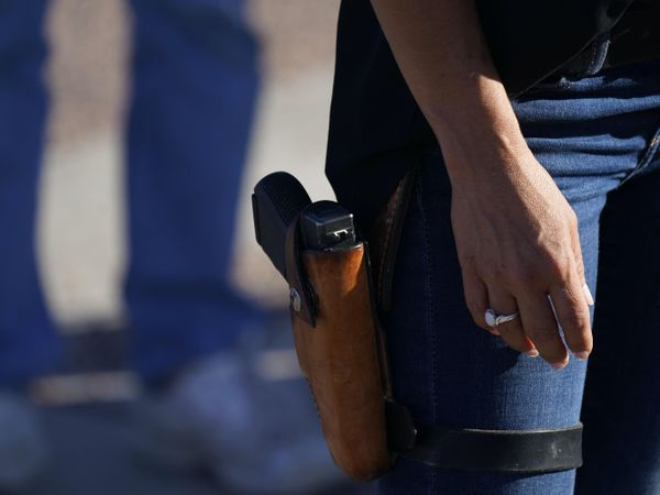 Lauren Boebert, the Republican candidate, with a gun in her holster (David Zalubowski/AP)