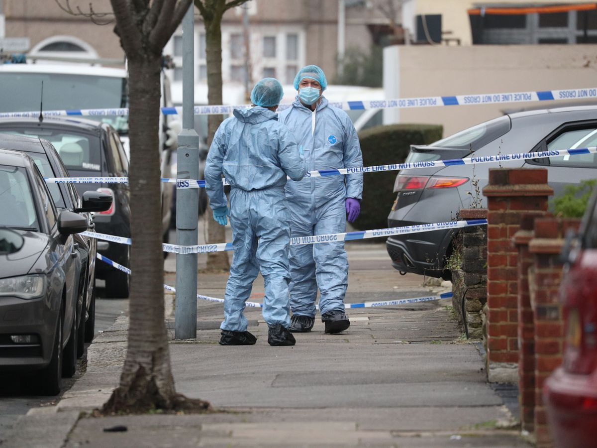 Forensic officers in Tavistock Gardens, Ilford, where two men died on Sunday